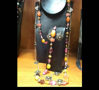 Spring Fever Quartz and Stone Glass shown with Whimsical Necklace